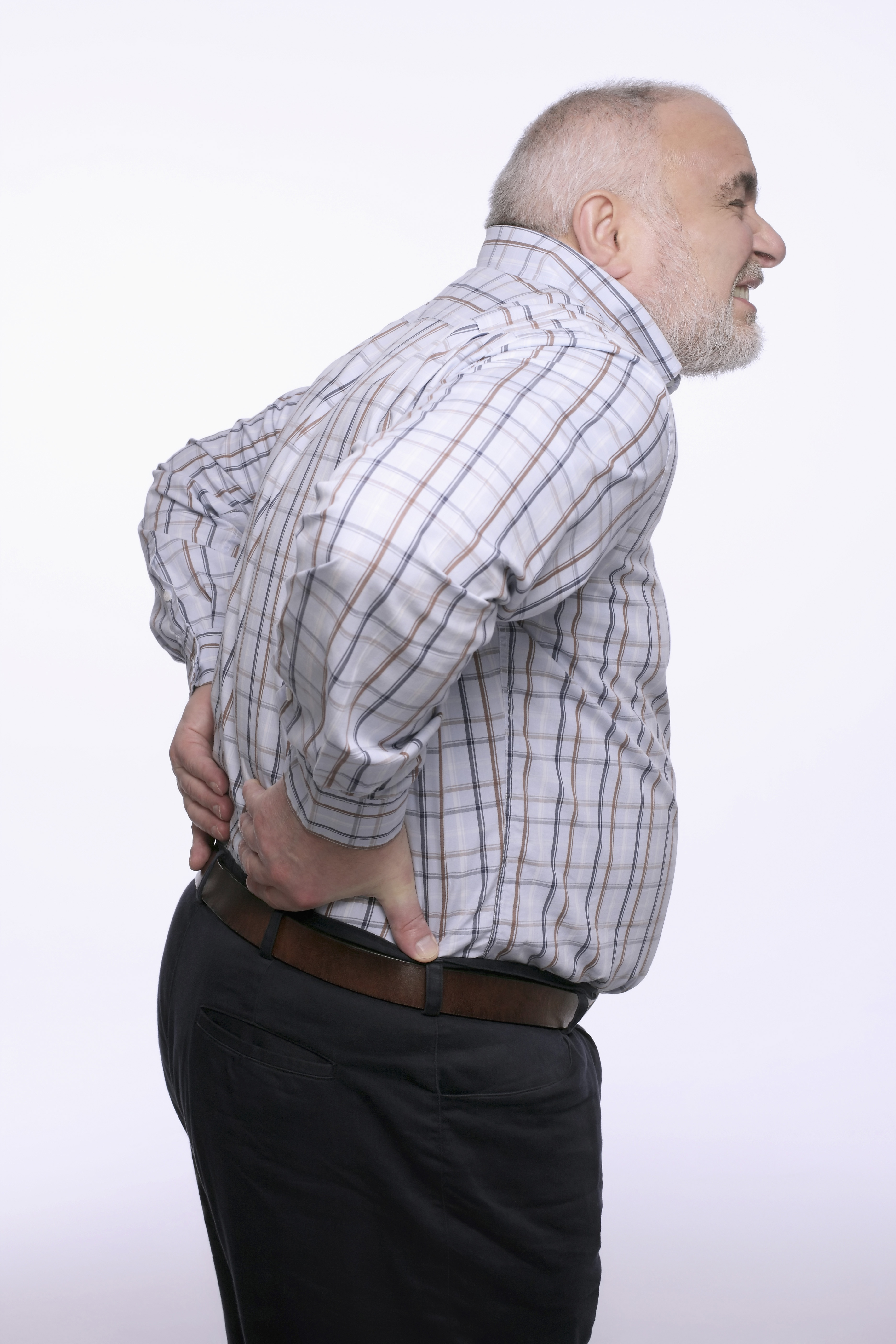 Bulging discs or herniated discs can cause back pain like this man is experiencing as he holds his lower back.