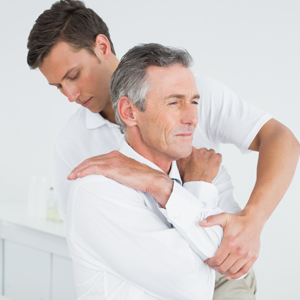 A chiropractor helps a patient